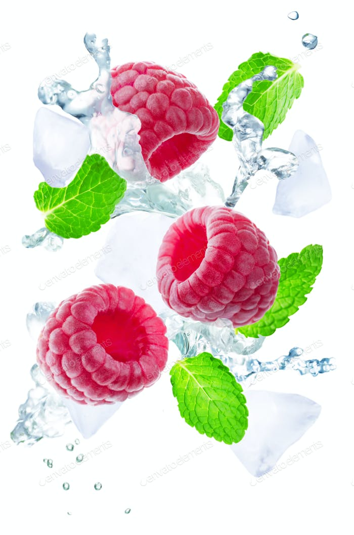 Flying Raspberry with mint leaves and a spray of water