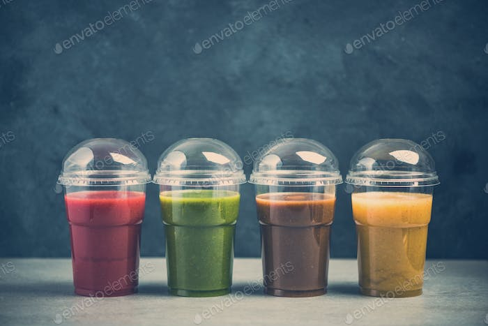 Colorful smoothie selection on dark slate background