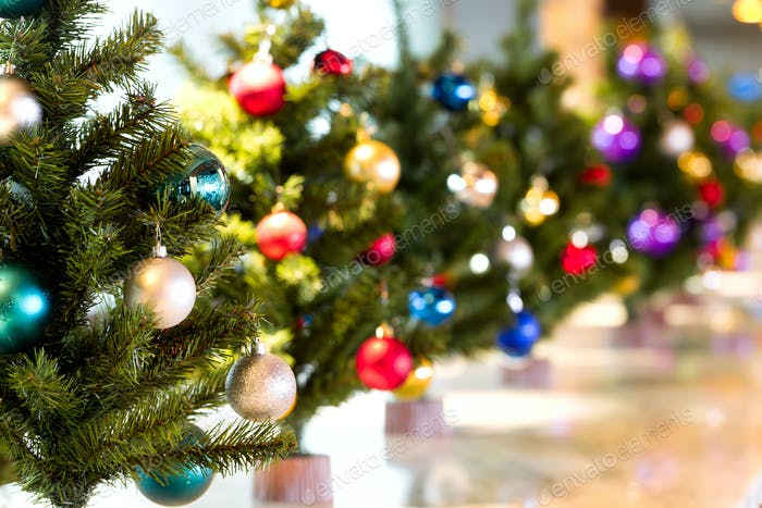 Christmas tree decorations hanging on a Christmas tree