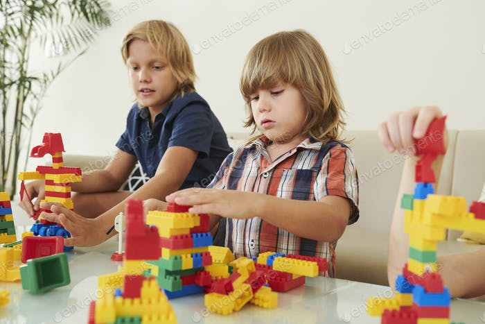 Little boy making bricks robot