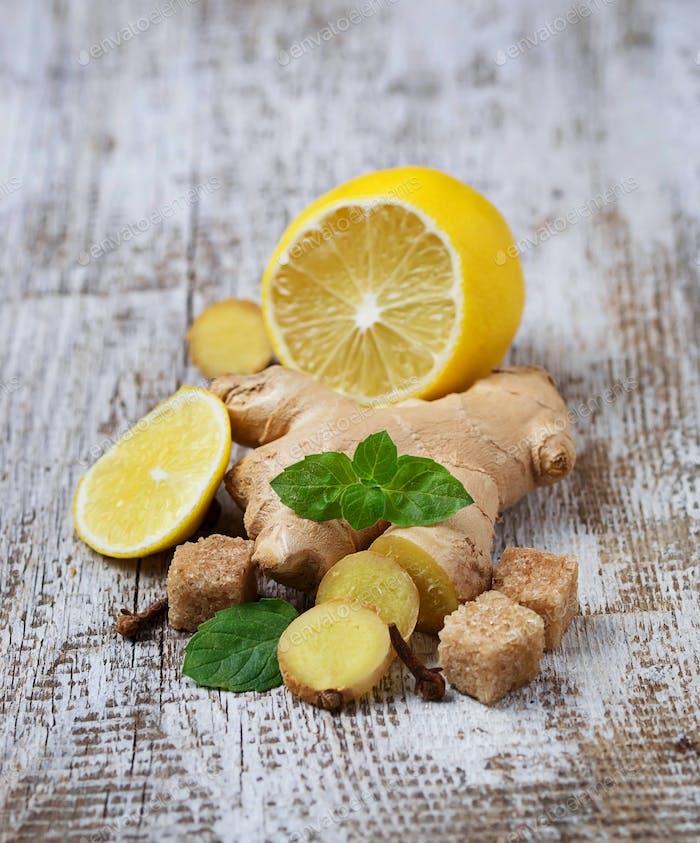Ginger, lemon and mint on light background