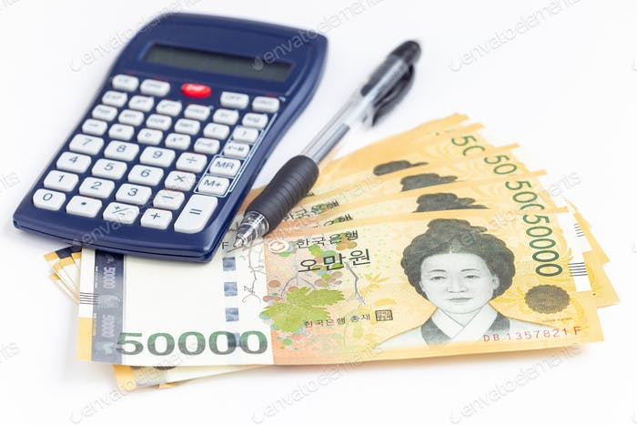 South Korea currency 50 000 won value with  pen and calculator, save money concept
