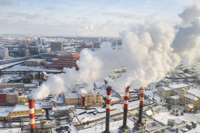 In the winter city, the factory's chimneys are smoking. The concept of air pollution