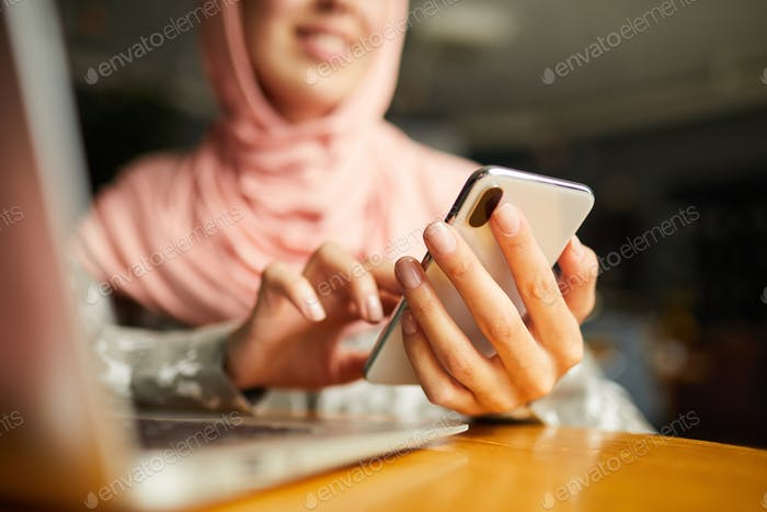 Hands of woman sending message