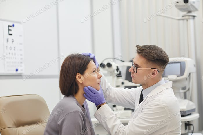 Ophthalmologist Examining Woman