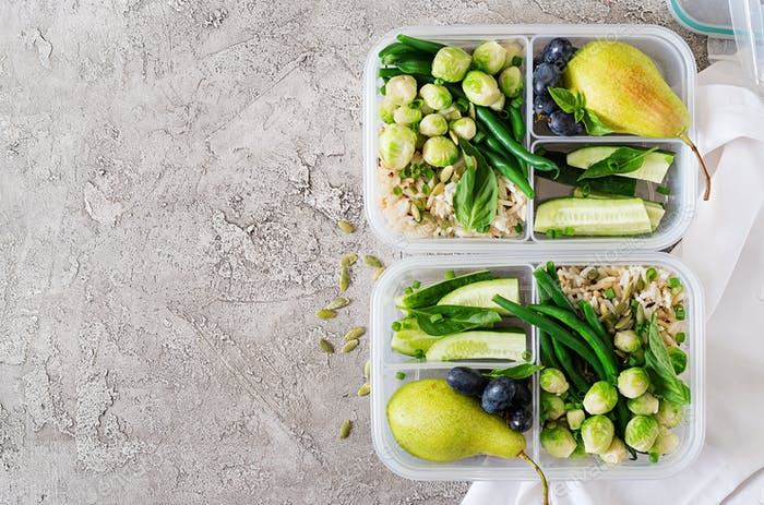 Vegan green meal prep containers with  rice, green beans,  brussel sprouts, cucumber and fruits