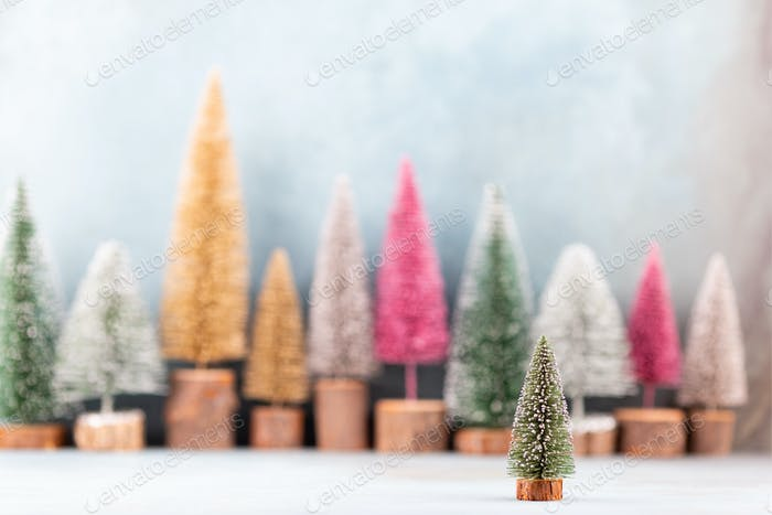 Colorful Christmas tree on blue background.