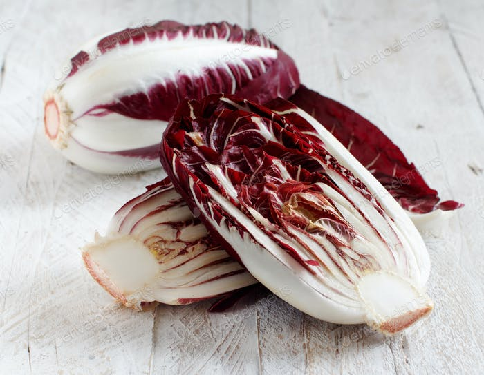 Raw red chicory on a tray close up
