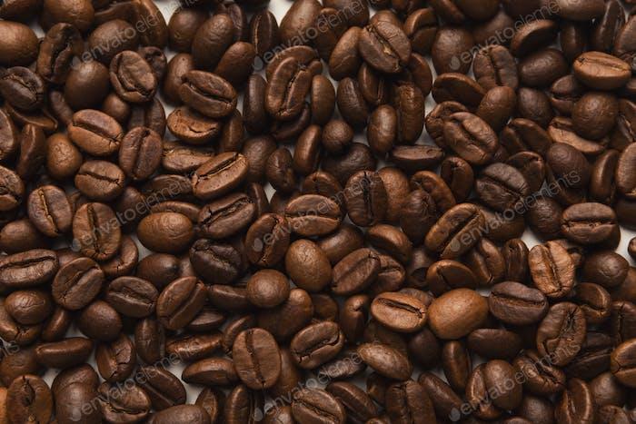 Nahaufnahme von Kaffeesamen, strukturierter Hintergrund