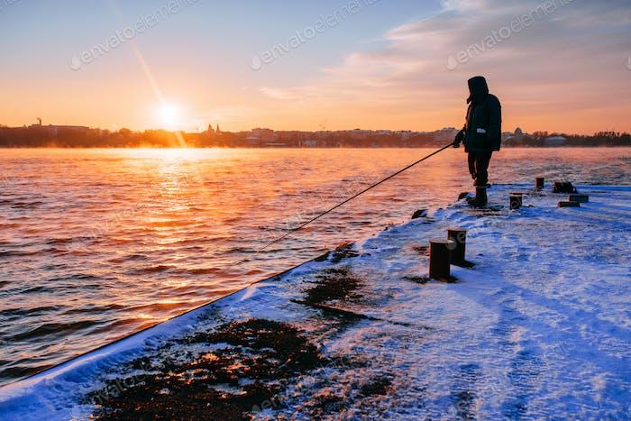 Silhouette of fishermen.
