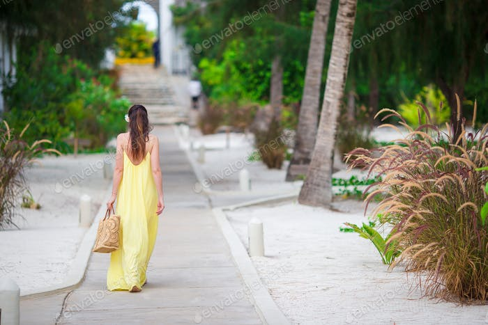 Beautiful woman on summer vacation in tropics. Outdoor lifestyle picture