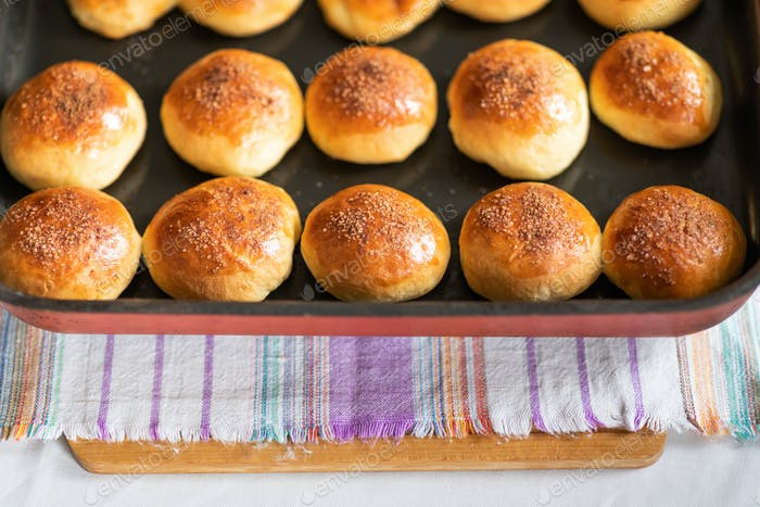 Appetizing buns stuffed with cinnamon sugar. Homemade dessert. Shallow depth of field