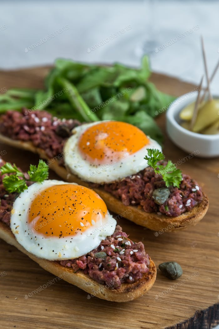 Beef tartare with pickled fried egg on top.