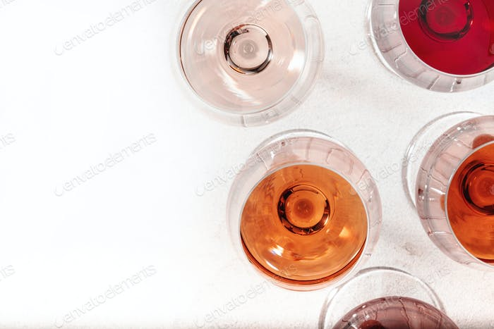 Degustation different varieties, colors and shades of pink wine