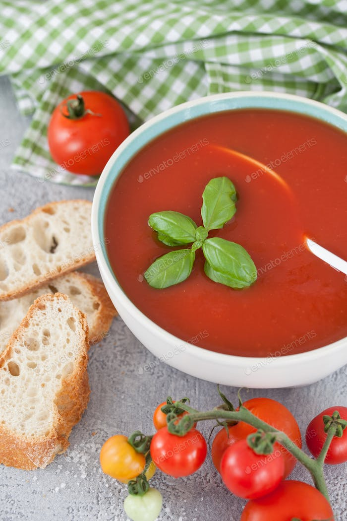 Homemade tomato soup with fresh basil