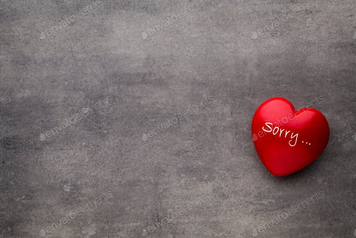 Valentine day  Red heart on the dark boards.