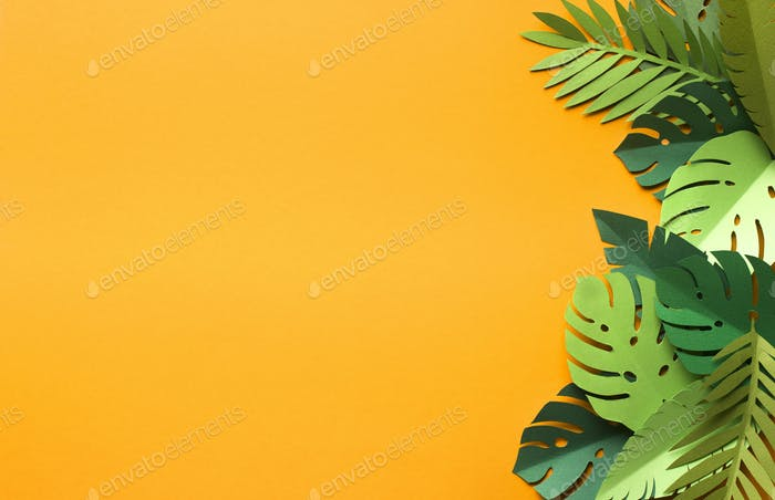 Yellow summer background with green monstera leaves