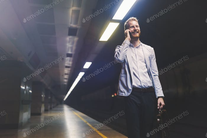 Businessman waiting for underground subway