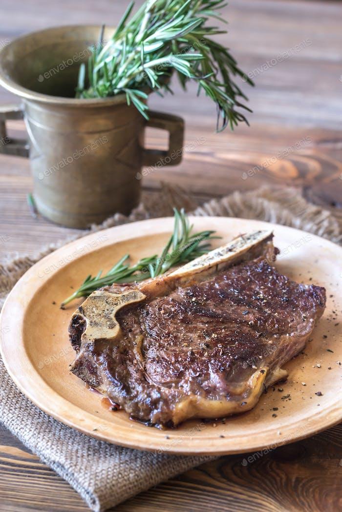 Beef steak with fresh rosemary