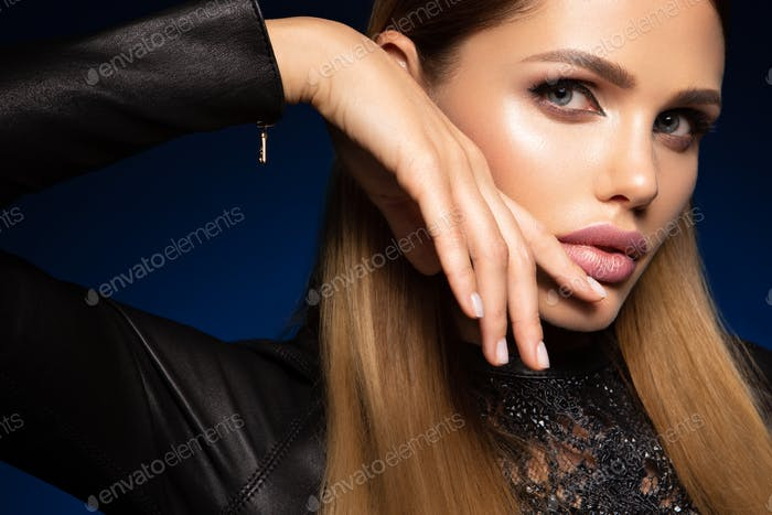 Beauty fashion portrait on blue wall background
