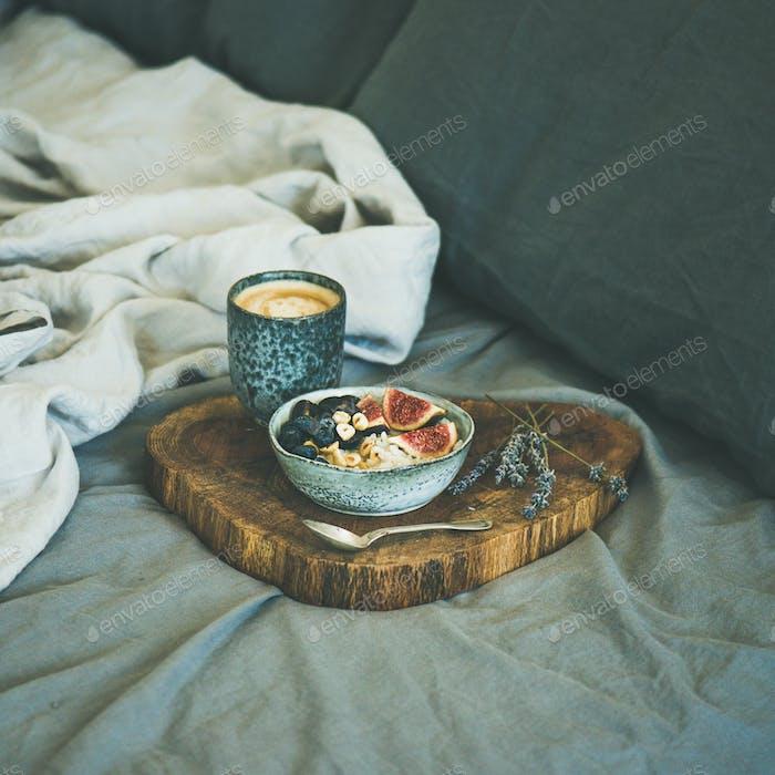 Rice coconut porridge and espresso in bed, square crop
