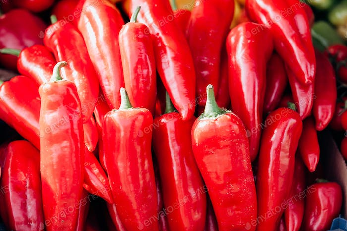 Heap Of Ripe Big Red Peppers as background. Background and red pepper