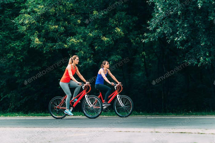 Two Women Cycling Together