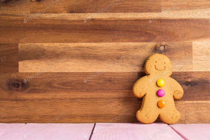 Gingerbread man leaning against the wall.
