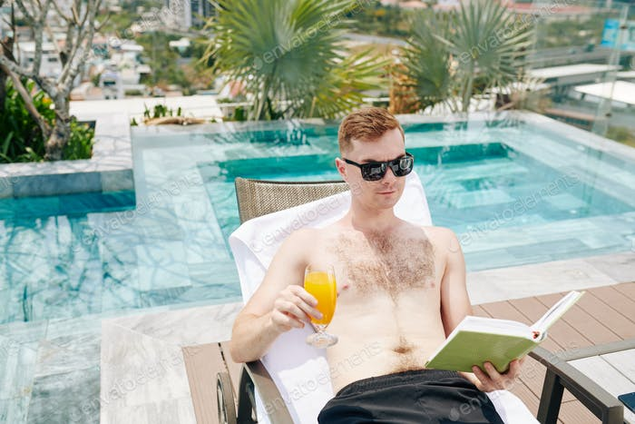 Man reading by pool