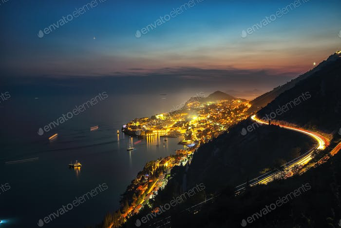 Aerial panoramic view of the old town of Dubrovnik in beautiful evening twilight at dusk.