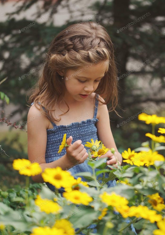 portrait of happy beautiful girl in flowerbed