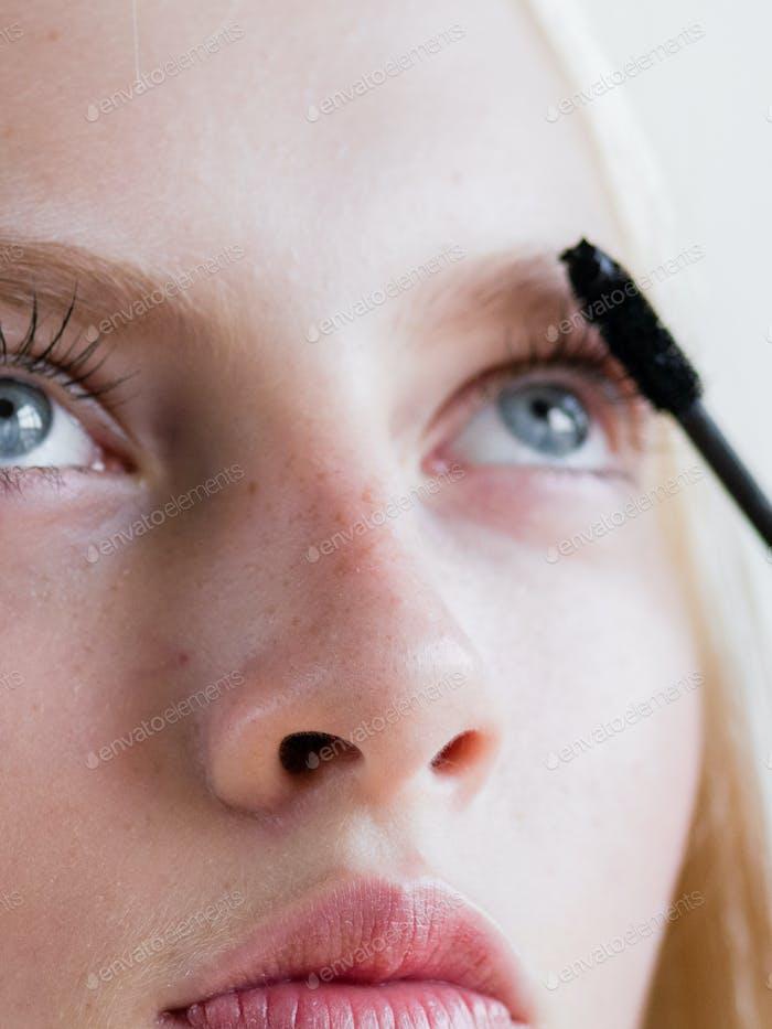 Makeup woman beauty brush applying cosmetic