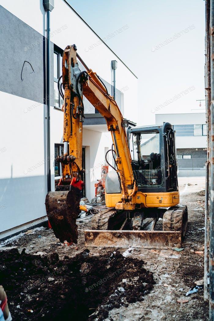 mini excavator digging on construction site