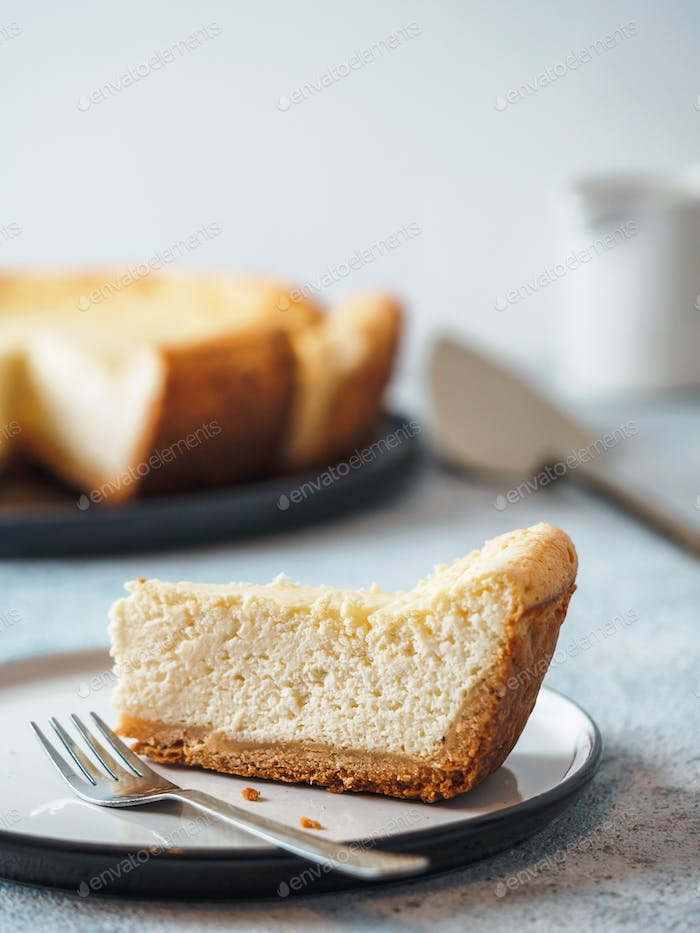 Classic Cheesecake on table, vertical