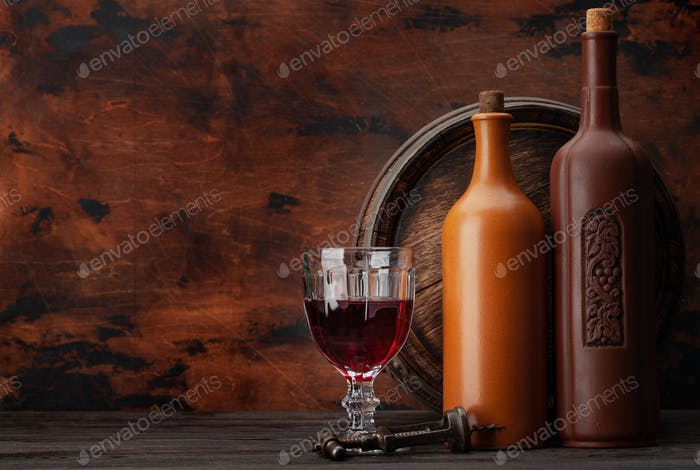 Wine bottles and old wooden barrel