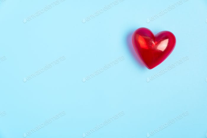 Red heart shape isolated on blue background