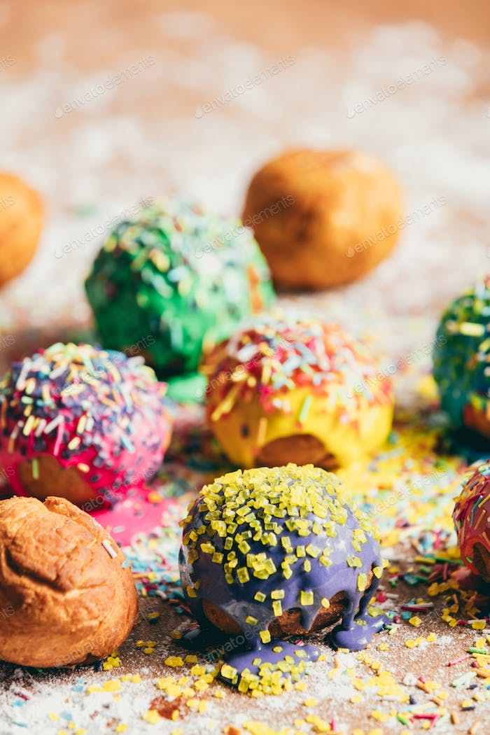 Colorful doughnuts on a kitchen counter.