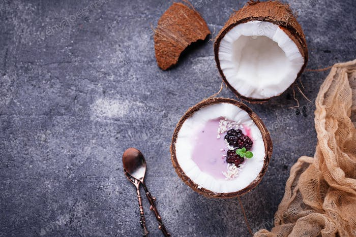 Blackberries smoothie in coconut shell