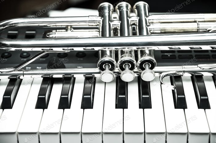 Trumpet on keyboard background