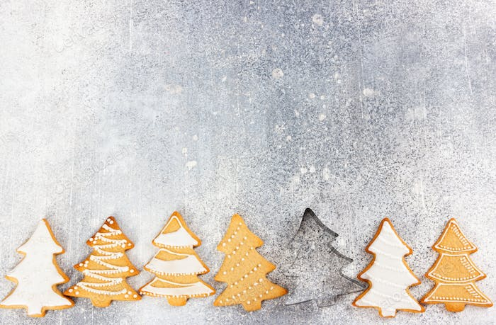 Christmas pattern of gingerbread cookies in the shape of Christmas tree