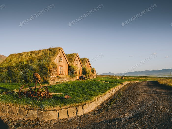 road and traditional icelandic houses with grass roofs, Iceland