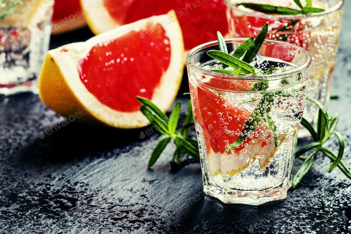 Citrus refreshing lemonade with rosemary and grapefruit