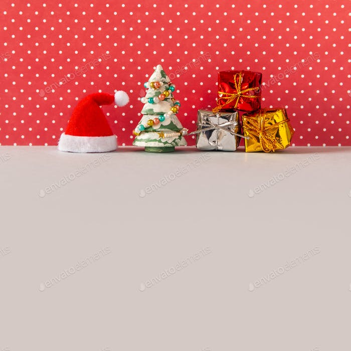 Funny kind postcard with Santa Claus hat, toy spruce tree, Xmas boxes gifts