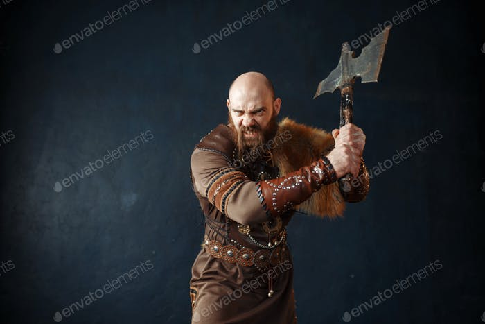 Angry viking with axe, barbarian image