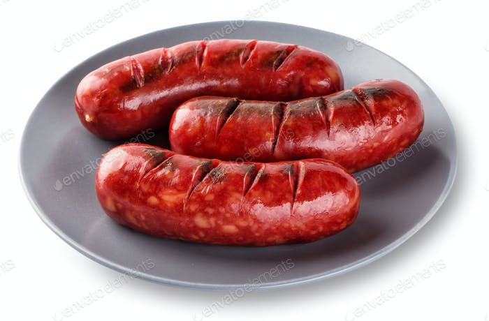 Grilled sausages cooked on a grill in gray plate