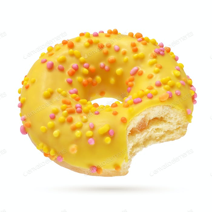 Yellow bitten donut isolated on white background.
