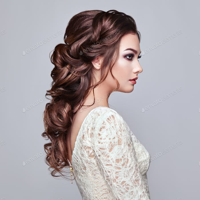 Brunette woman with long and shiny curly hair
