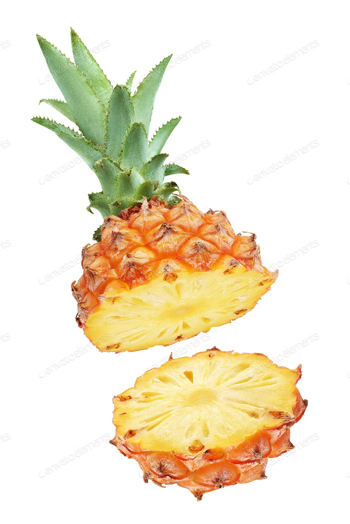 One halved pineapple and two slices isolated on white