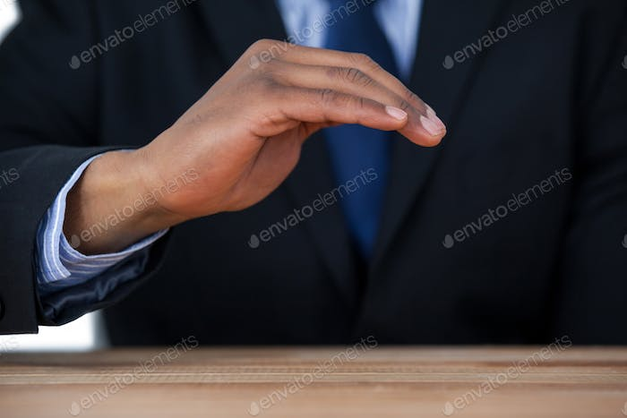 Businessman protecting invisible object