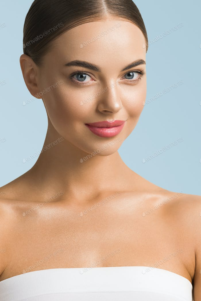 Beauty woman skin care beautiful female cosmetic girl model over blue background